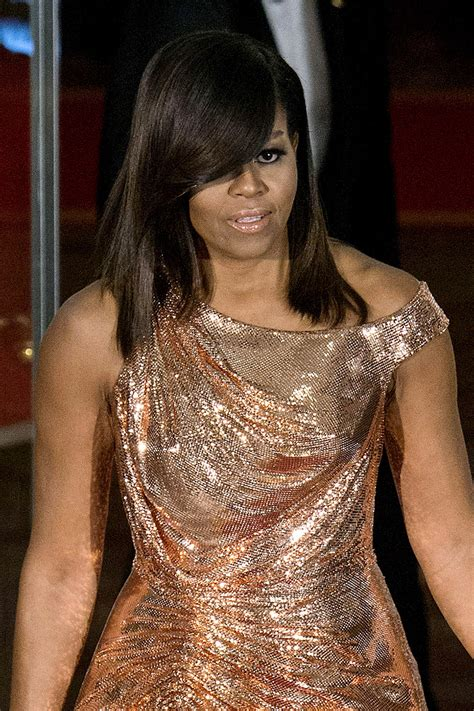 what did rhe pull back hairdos on michelle obama michelle obama hairstyles essence com