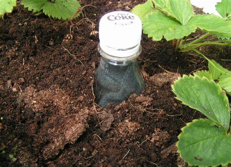 plastic bottle irrigation system gardening tips 19 quot zero dollar quot hacks bob vila