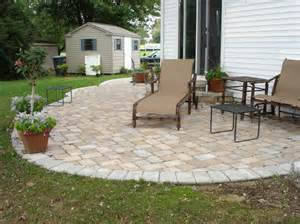 eco friendly cool backyard ideas with grey outdoor patio lounge chairs and brick stone tile