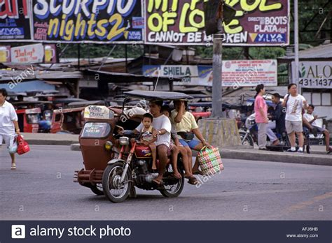 philippines motorcycle taxi motorcycle taxi and passengers manila philippines stock