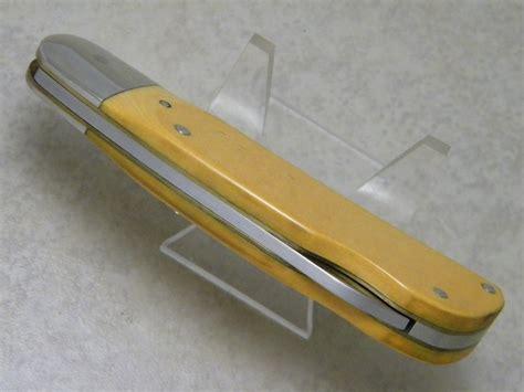 schrade buck knife schrade usa sc504 buck deer scrimshaw yellow micarta