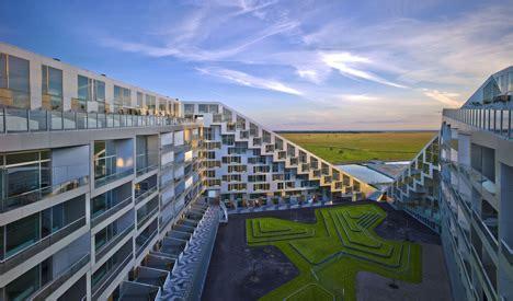 big s 8 house wins the 2010 scandinavian green roof award 8 house by big architects copenhagen denmark archide