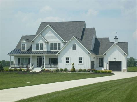 white siding houses with black shutters charcoal roofs and white houses white siding black standing seam roof circleville