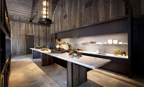 The large island in this modern kitchen creates a perfect area for