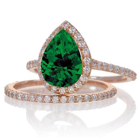 2 carat emerald and halo bridal ring set on 10k