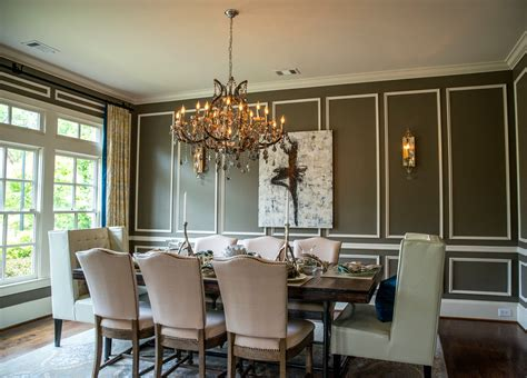 traditional dining room with wall sconce by art wall panel with white trim dining room traditional and