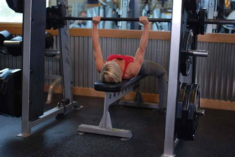 bench press with smith machine smith machine bench press exercise guide and video