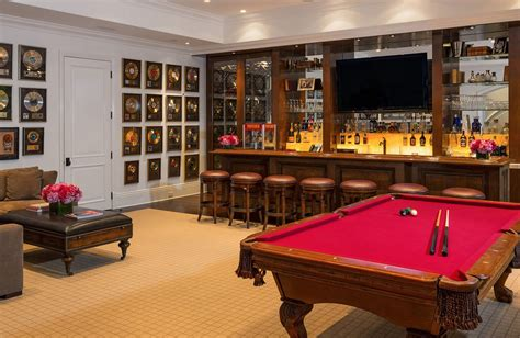 the room includes a bar and pool table david