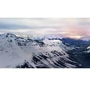 Snowy Mountain Range Distant Storm 4K Desktop Wallpaper