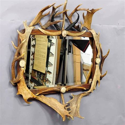 antique antler frame with rustic antler decorations and