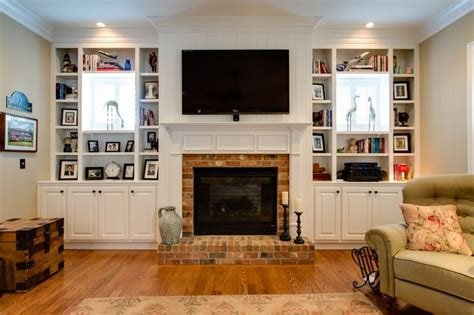 built in shelves around fireplace with windows built in bookshelves around small square window