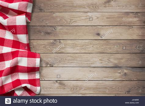 wood pattern tablecloth red picnic tablecloth on wood table background stock photo