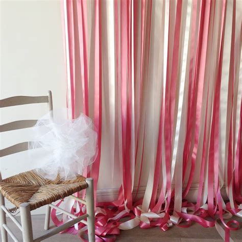 ribbon curtains pink and cream ribbon backdrop on white pole with ivy by