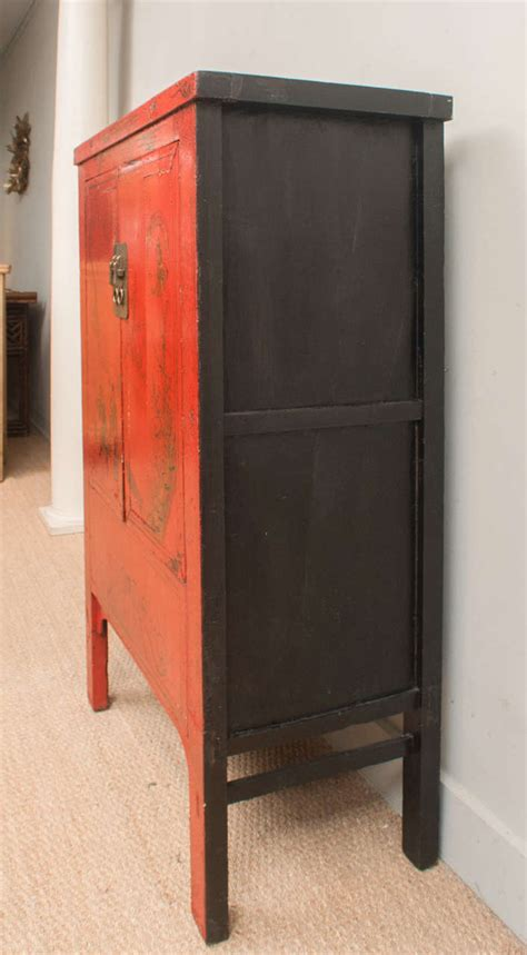 red or black lacquer gilt chinese red lacquer cabinet with gilt painting 19th