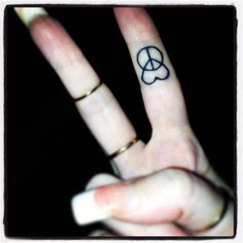 peace and love tattoos designs peace and fingertattoo this but i already