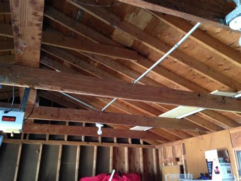 how to insulate a garage door yourself garage ceiling insulation doityourself community forums
