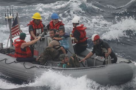 hells bay boats jobs sick infant family safely aboard navy ship following