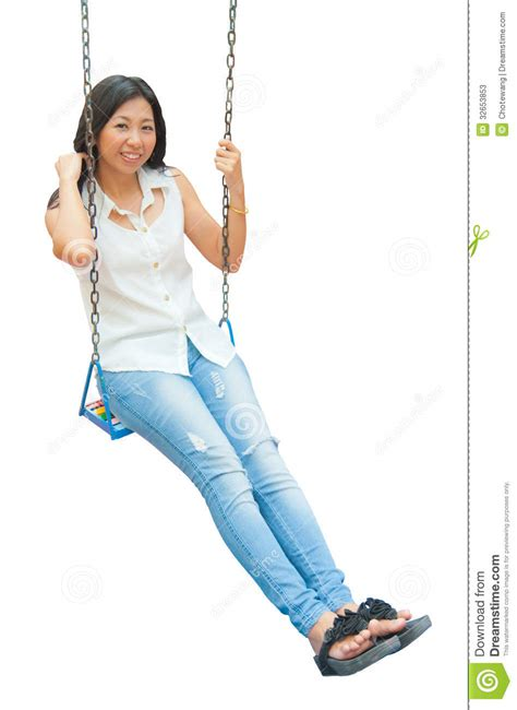 swing asia an asian woman relaxing on a swing stock photos image