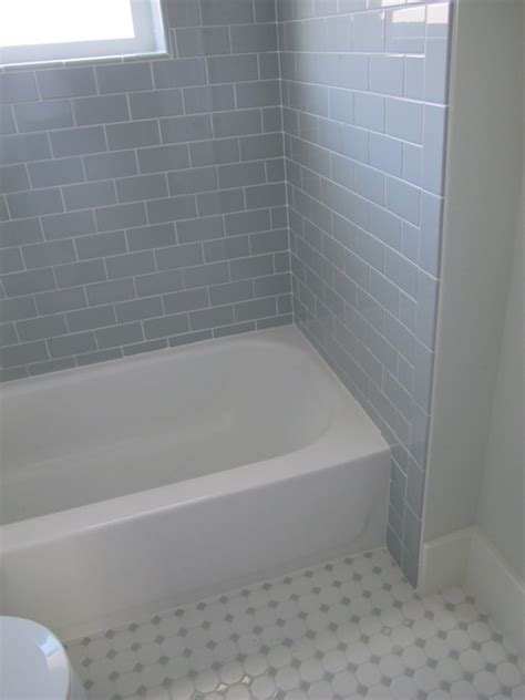 gray subway tile contemporary bathroom white gold