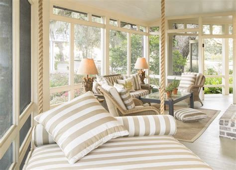 Screened Porch With Natural Wicker And Porch Swing