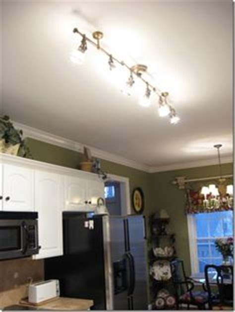 replace fluorescent light in kitchen with track lighting florida dream home on pinterest mobile homes dimplex