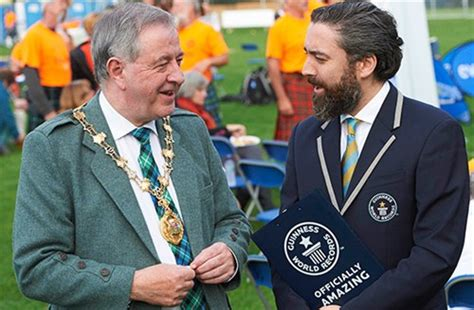 tossing simultaneously world record set in inverness watch video here scottish history made caber tossing world record set in