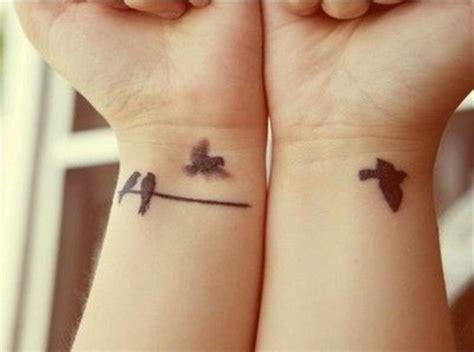wrist tattoo bird on branch flying bird tales of tattoos bird