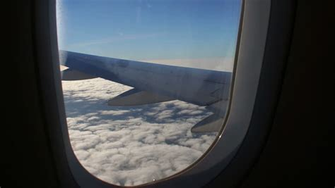 how to get window seat in flight airplane window seat view of wing of plane on flight