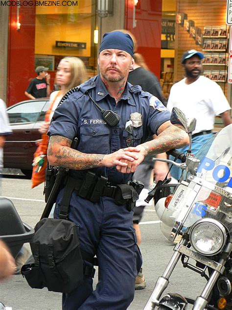 police with tattoos tattooed motorcycle bme piercing and
