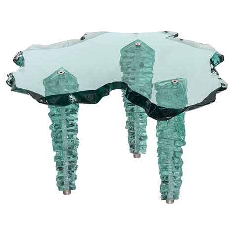 a glass coffee table by danny