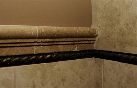 granite chair rail tile from floors to the wall