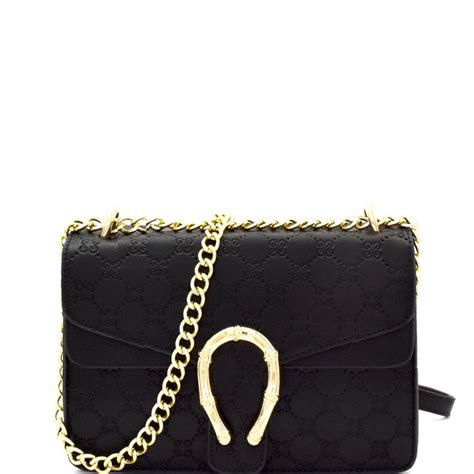 monogram embossed horseshoe accent shoulder bag mh yh
