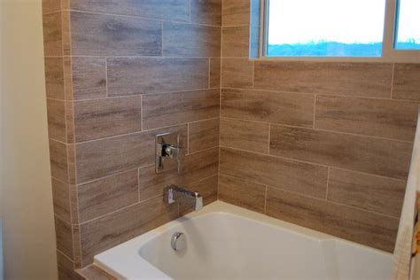 wood look tile in bathroom wood textured tiles on tub surround bathroom remodel