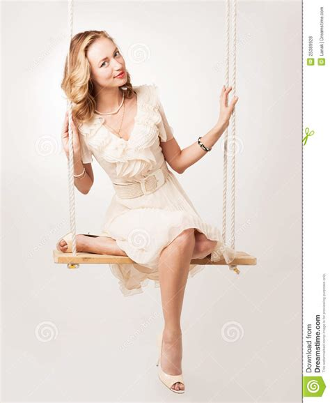 woman on a swing woman on a swing royalty free stock photos image 25389928