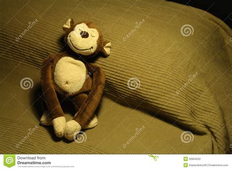 monkey on the bed smiling stuffed toy monkey on bed stock photography