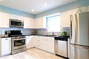 white kitchen cabinets stainless steel appliances simple sweet dave fox