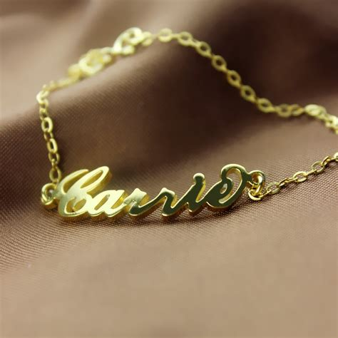 gold carrie name bracelet