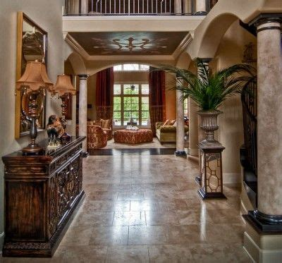 faux painted columns  arches grand entryway house