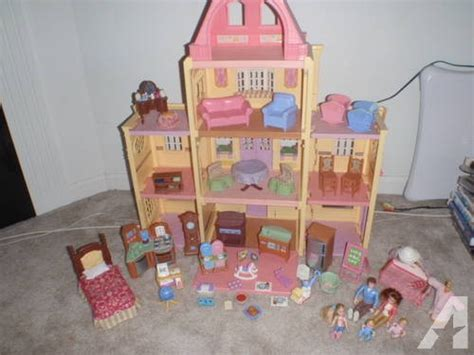 3 story dollhouse with elevator 3 story kidkraft wooden glitter dollhouse w elevator for