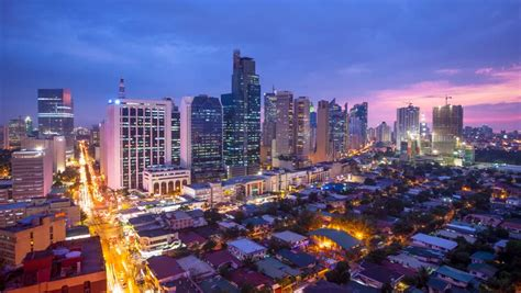 9691 New Manila Blue 1 timelapse view makati city in metro manila philippines by 4k stock clip