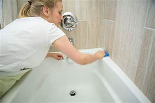 to clean the bathroom how to clean a refinished bathtub