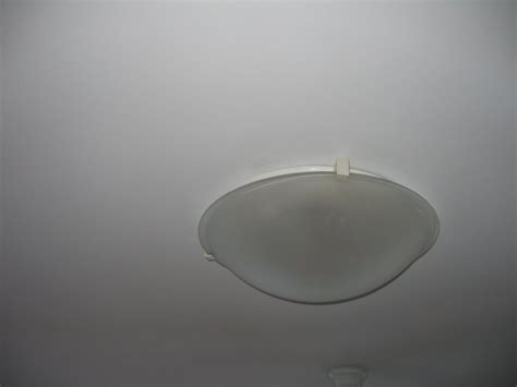 can t remove globe from ceiling light