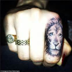 finger tattoo artist nyc cara delevingne continues with her ink addiction as she