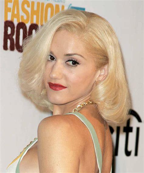 gwen stefani hairstyle medium blonde curly hairstyle with bangs gwen stefani medium straight formal hairstyle
