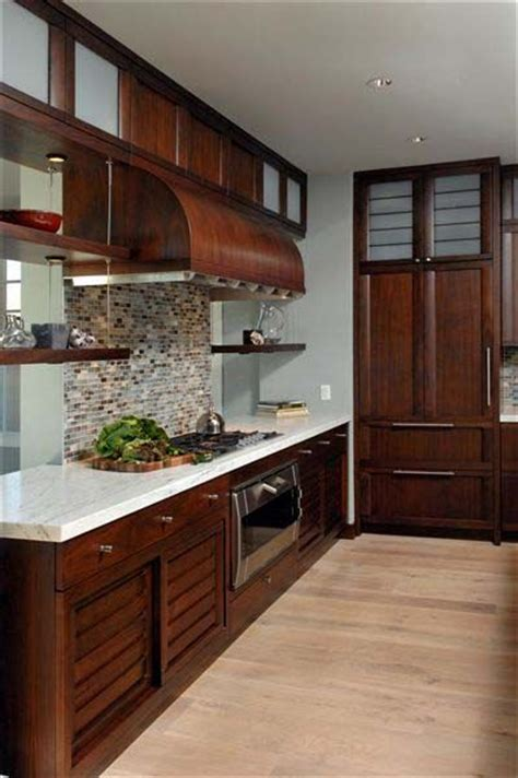 light walnut kitchen cabinets dark cherry cabinets light countertops pretty backsplash