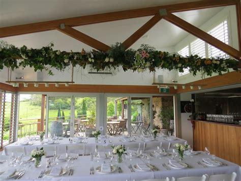 beam decoration, flower garland, barn wedding, ceiling