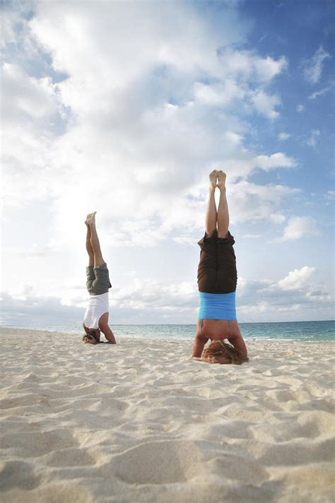 swing heaven canada headstand on beach by brandon tabiolo printscapes