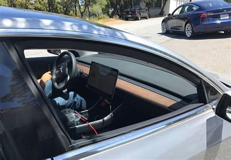 new interior image of tesla model 3 surfaces new photos of tesla model 3 interior dashboard center