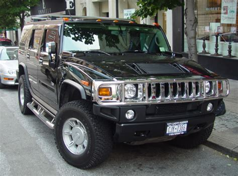Jeep That Looks Like A Hummer A Pedestrian S Of Cars