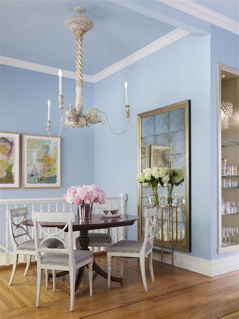 blue eclectic dining room with oversized chandelier hgtv